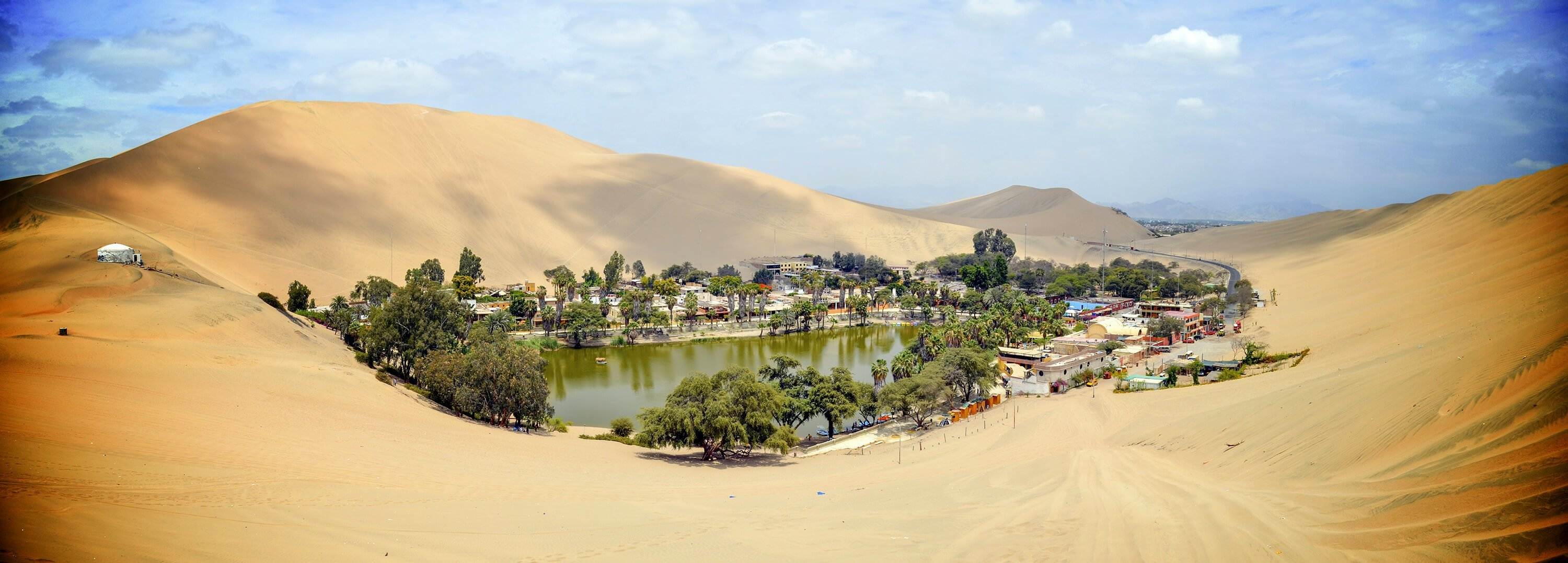 Huacachina in Peru is a beautiful oasis among the sand dunes