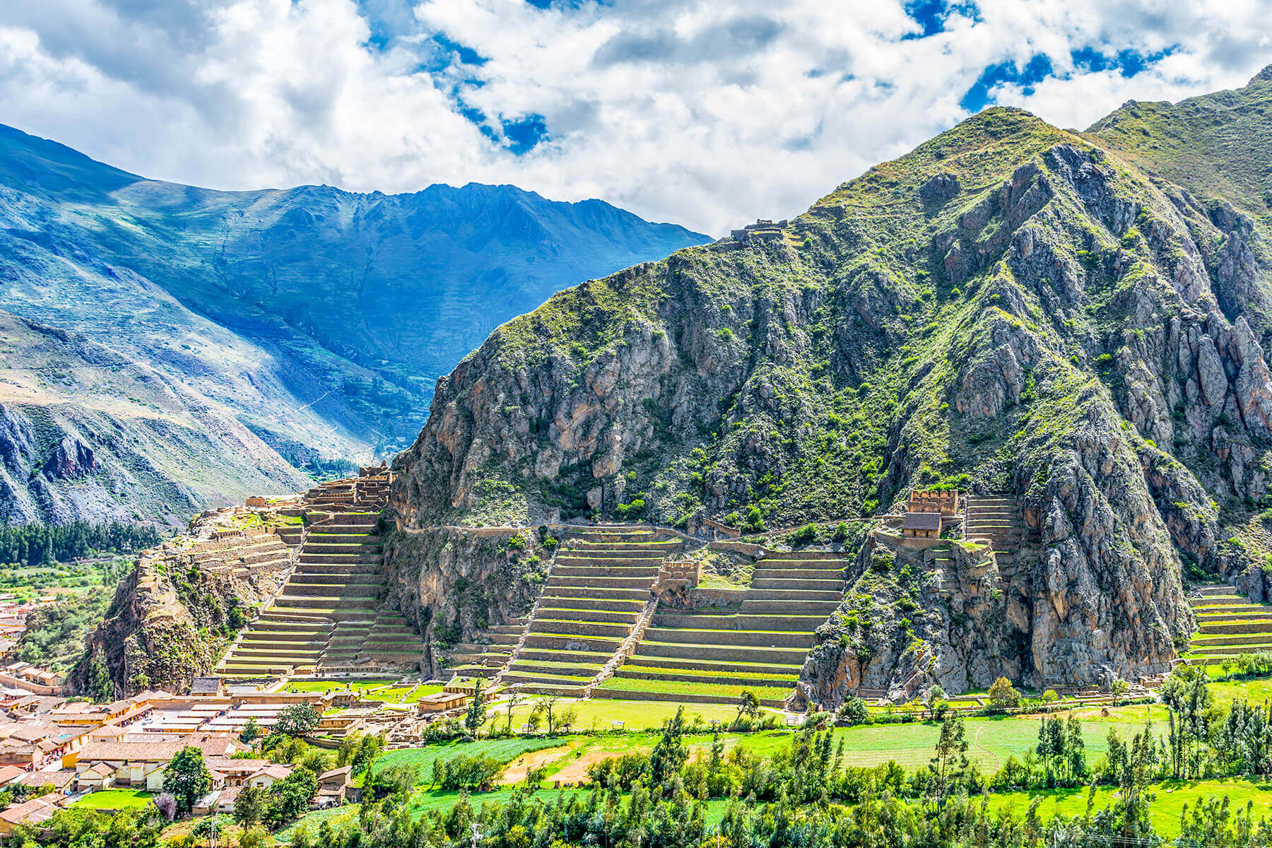 Inca fortress with terraces and temple in Sacred Valley - Ollantaytambo Peru
