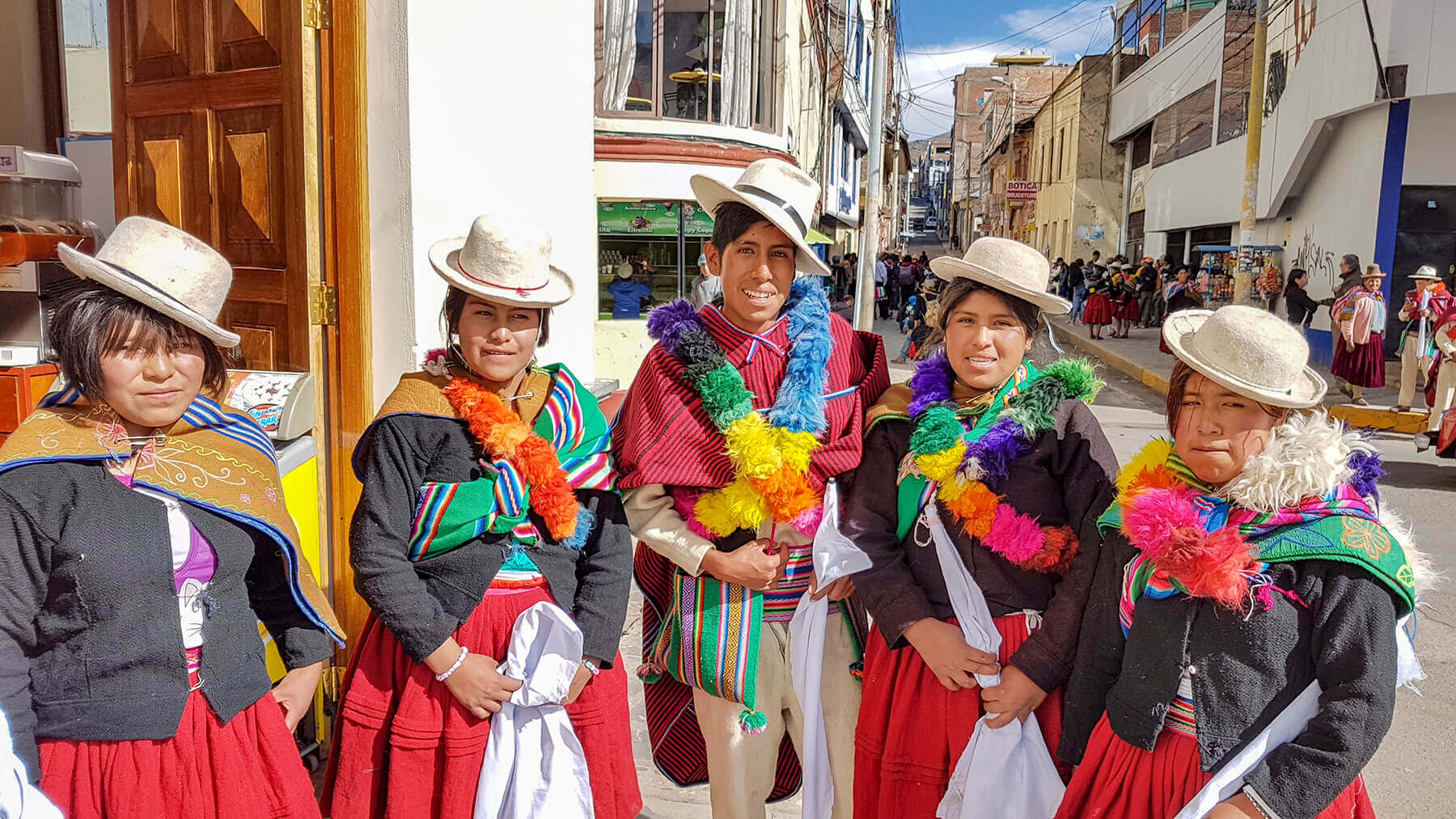 Peruvian ladies in traditional clothing in Puno at Lake Titicaca