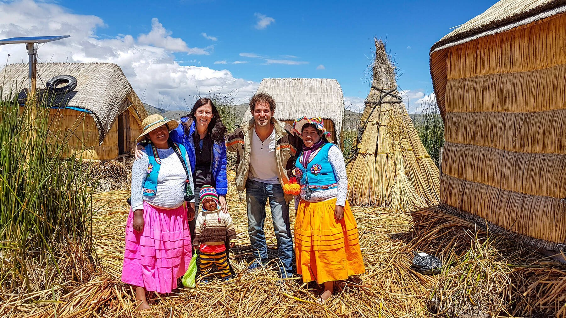 Uros islands in Lake Titicaca - Monique and Ydwer together with the locals on the photo